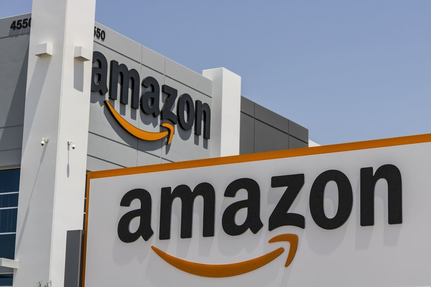 Street view of Amazon distribution center building with white signs and logo, Las Vegas, Nevada
