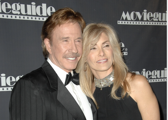 Chuck Norris posing for a photo with his wife, Gina at the 17th Annual Movieguide Faith and Values Awards Gala