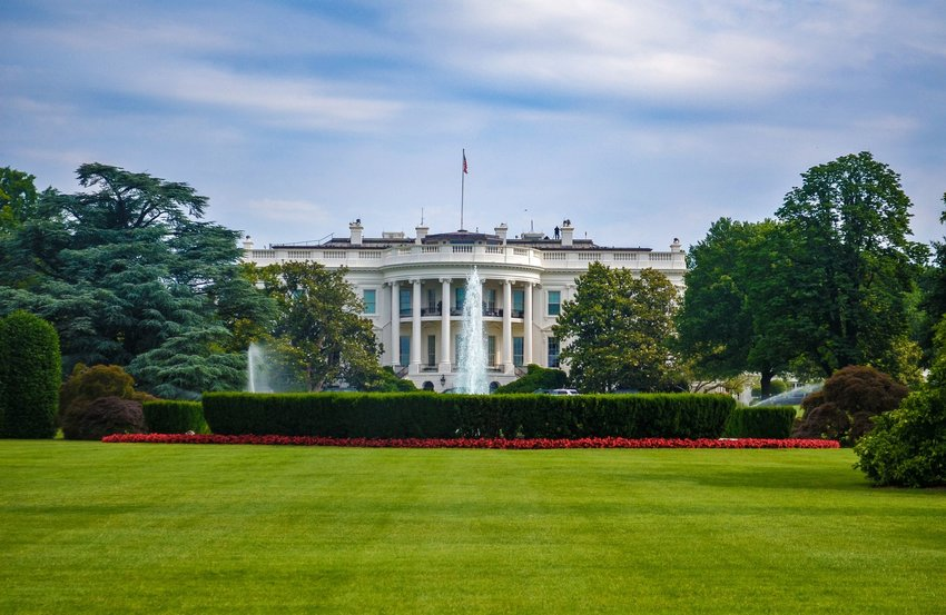 The White House with fountains in front and greenery