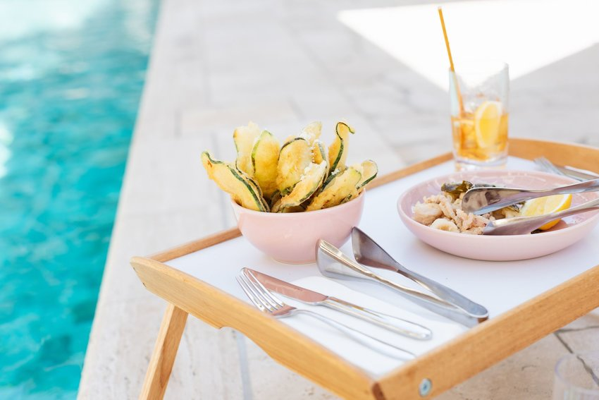 A tray of food sitting next to a pool