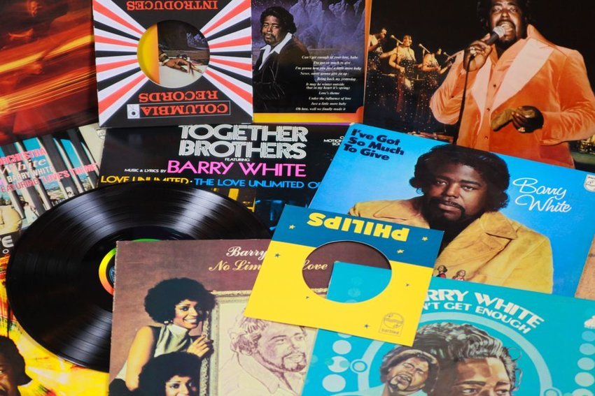 Stack of Barry White vinyl records and different albums