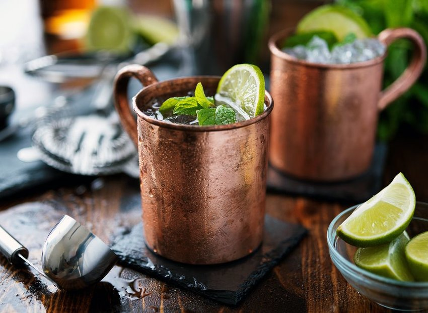 Moscow Mule cocktail with garnish, served in a ceramic mug