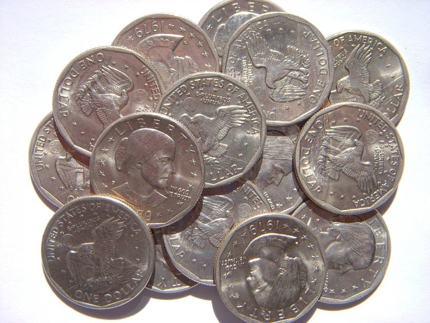 Stack of shiny Susan B. Anthony dollar coins in a pile