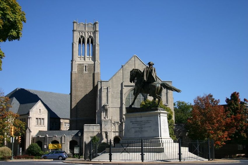 Monument to Patrick Henry, showing large cathedral and bronze statue