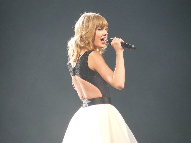Taylor Swift singing during her RED album tour