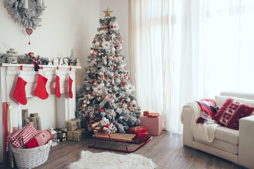 Family room decorated with Christmas tree and stockings
