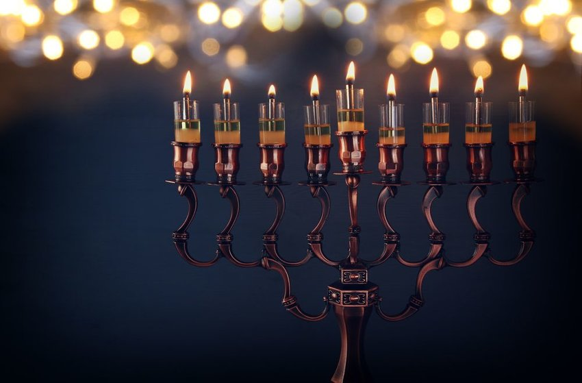 Hanukkah Menorah with blurry lights in background
