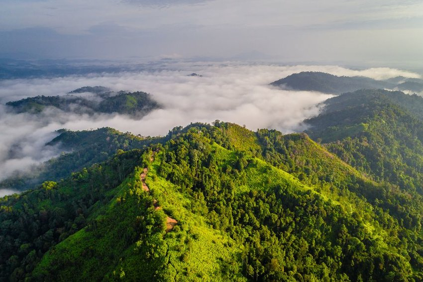 Aerial view of mountain range above clouds in Malaysia