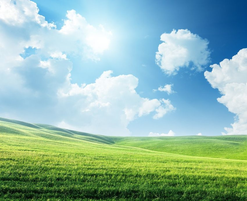 Open landscape under scattered clouds and brightly shining sun