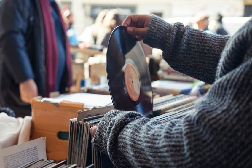 Person looking through old-fashioned vinyl records at music store