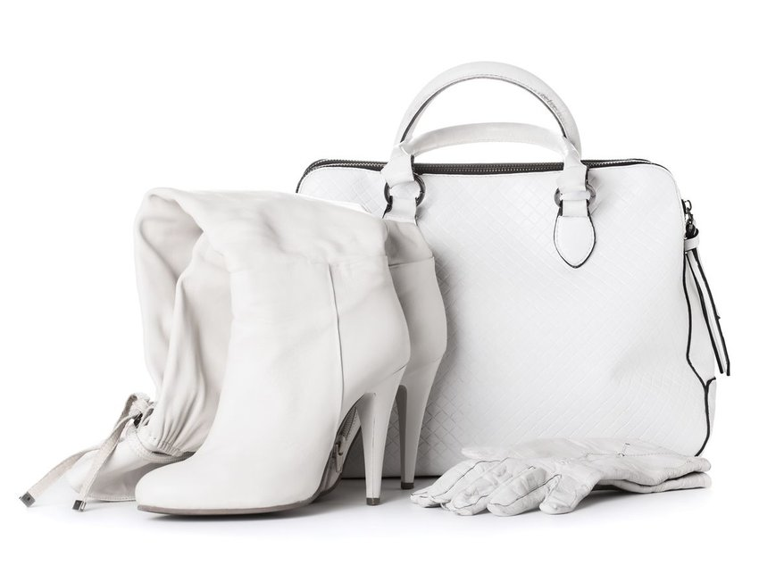 Collection of high white boots, gloves, and handbag