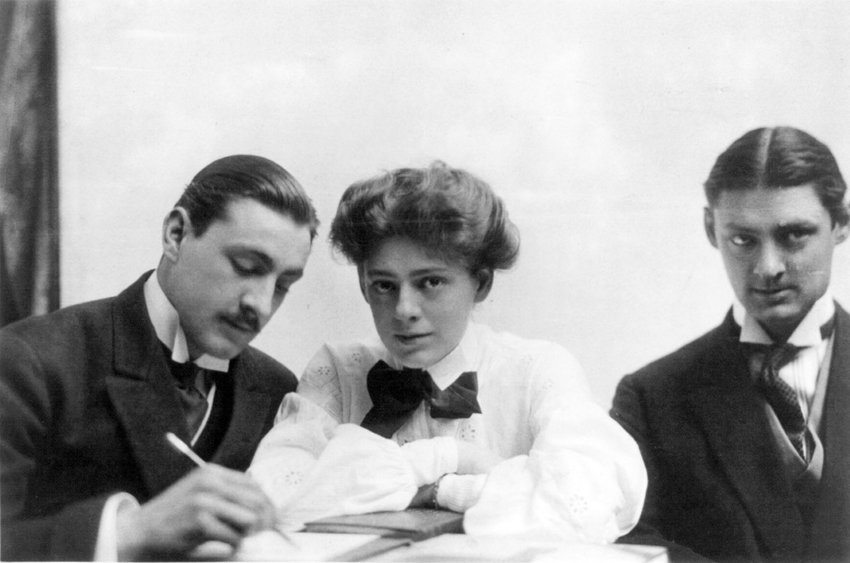 Lionel, Ethel, and John Barrymore seated at table