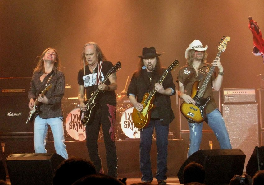 Lynyrd Skynyrd band performing on stage together