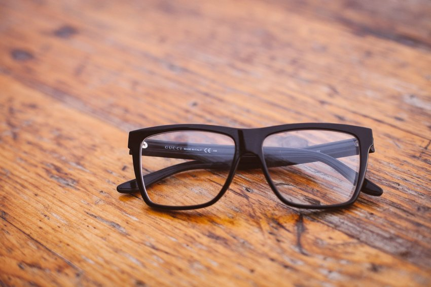 A pair of glasses sitting on a wooden table