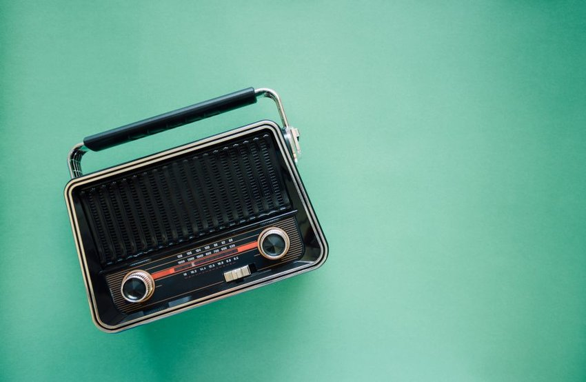Old fashioned radio on green background