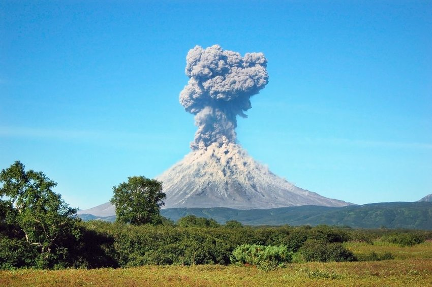 Volcano erupting into a clear, blue sky