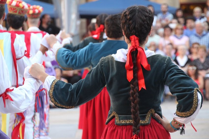 Group of dancers performing traditional Basque dance at folk festival