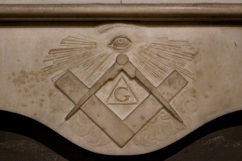 Ancient Masonic symbol engraved in stone banner