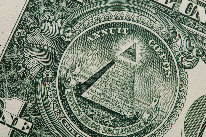 Up close view of American dollar bill showing iconic eye and imagery