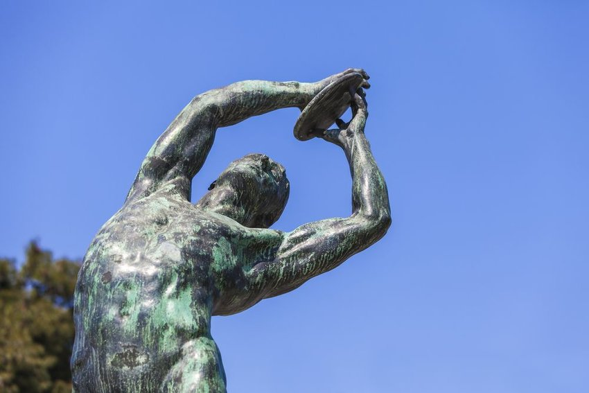 Bronze statue of disc thrower at the Panathenaic Stadium in Athens, site of first Olympic Games