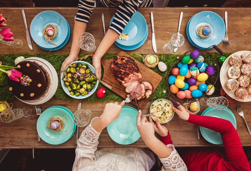 People sitting together at a table in celebration of Easter