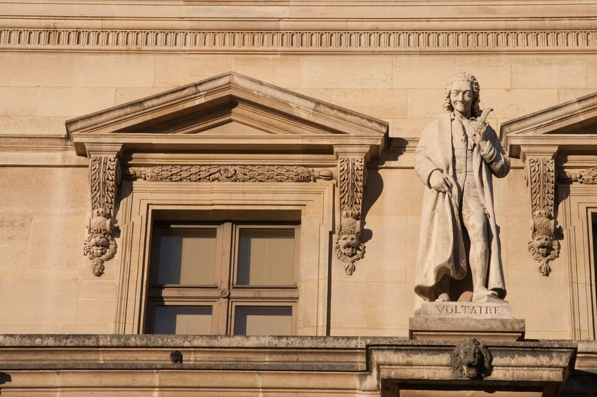 The statue of Voltaire on the internal face of Louvre in Paris