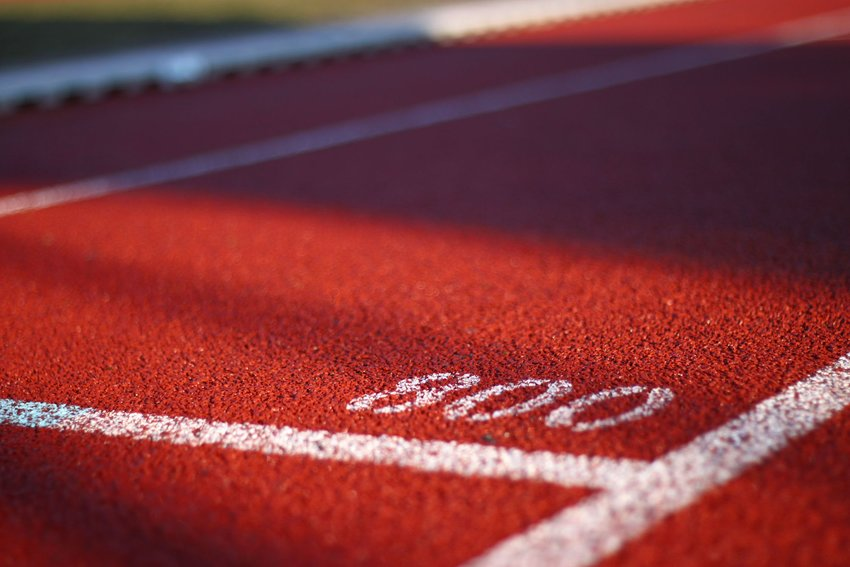 Close up shot of the red track with white lines
