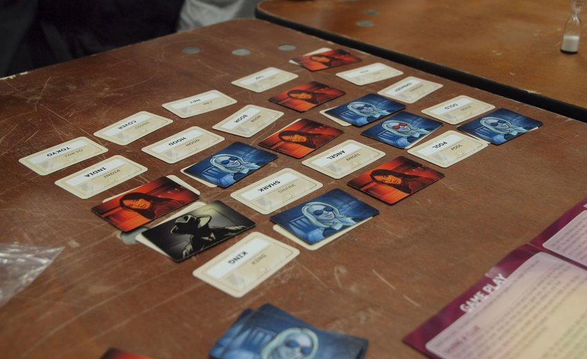 Codenames game cards on a wooden table