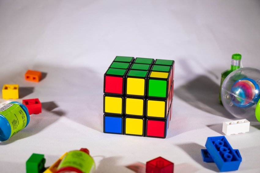 Up close view of Rubik's Cube showing yellow cross on front surface