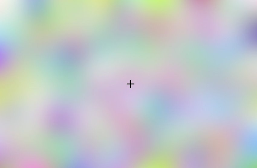 A black cross over a colorful out of focus picture