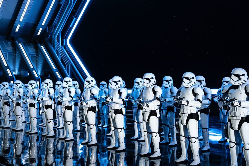 Two rows of storm troopers standing uniformly at Disney World