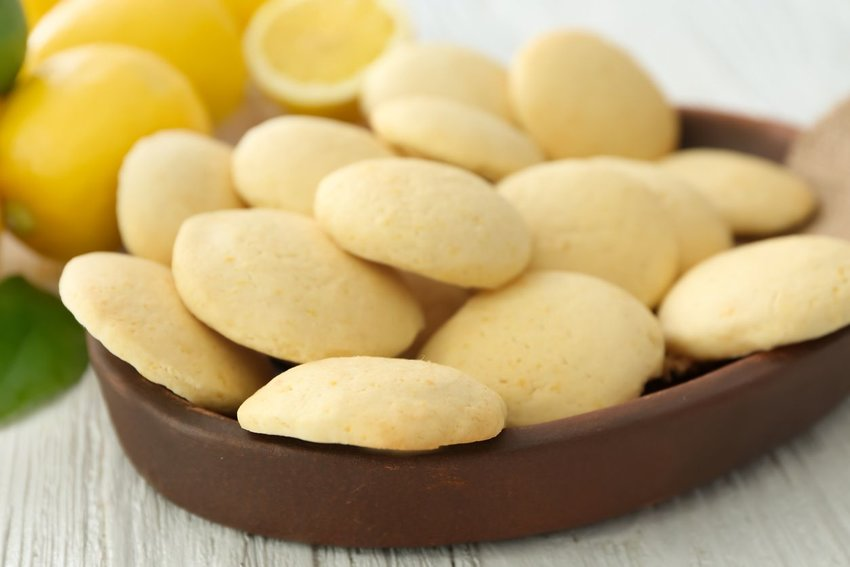 Lemon cookies stacked in a bowl