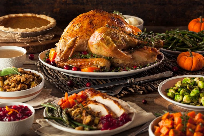 Thanksgiving dinner with turkey, stuffing, and vegetables