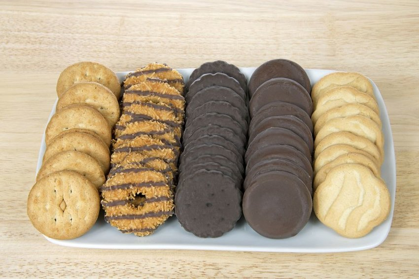 Arrangement of five different types of Girl Scout cookies