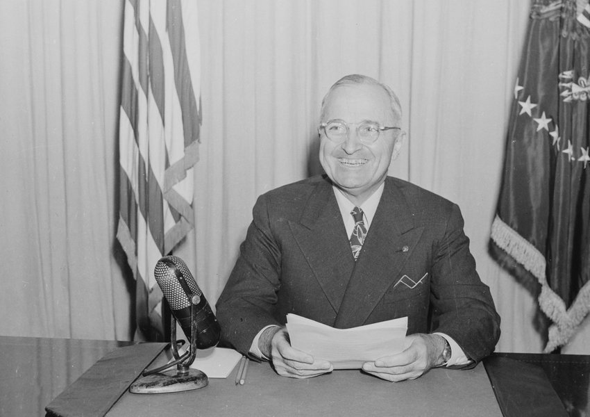 Photograph of President Truman smiling, on the occasion of his radio speech to the nation on the reconversion program