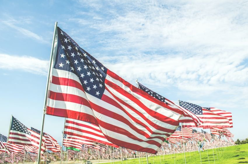 American flags waving on a field.