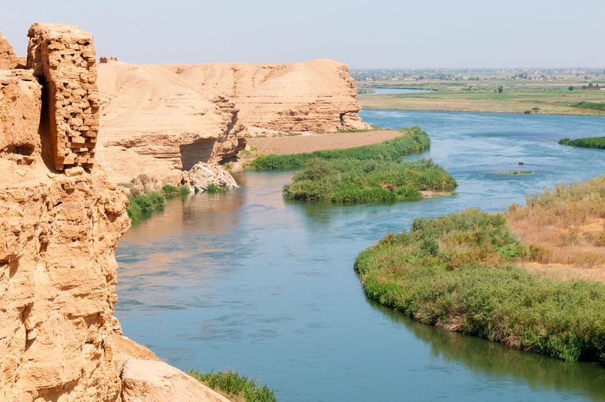 Euphrates river with ancient ruins on left