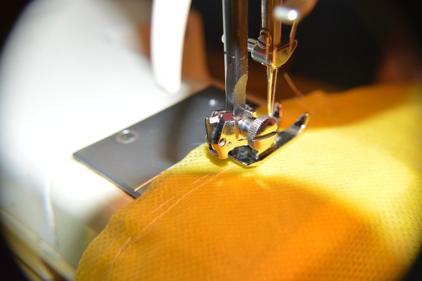 Sewing machine with yellow fabric