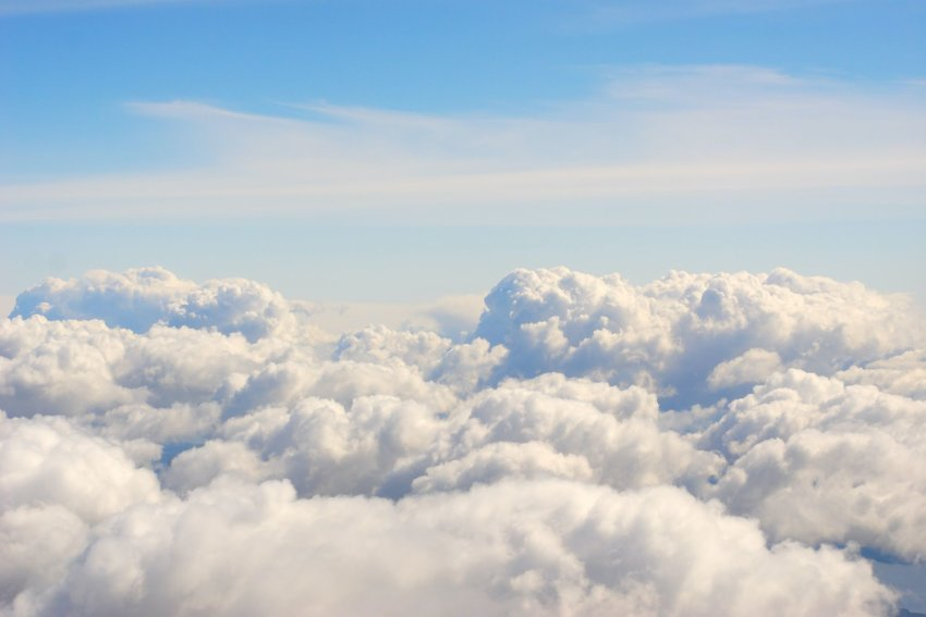 Group of fluffy clouds with blue sky