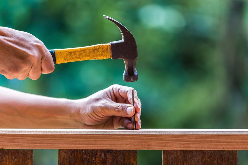 Person using a hammer and nails
