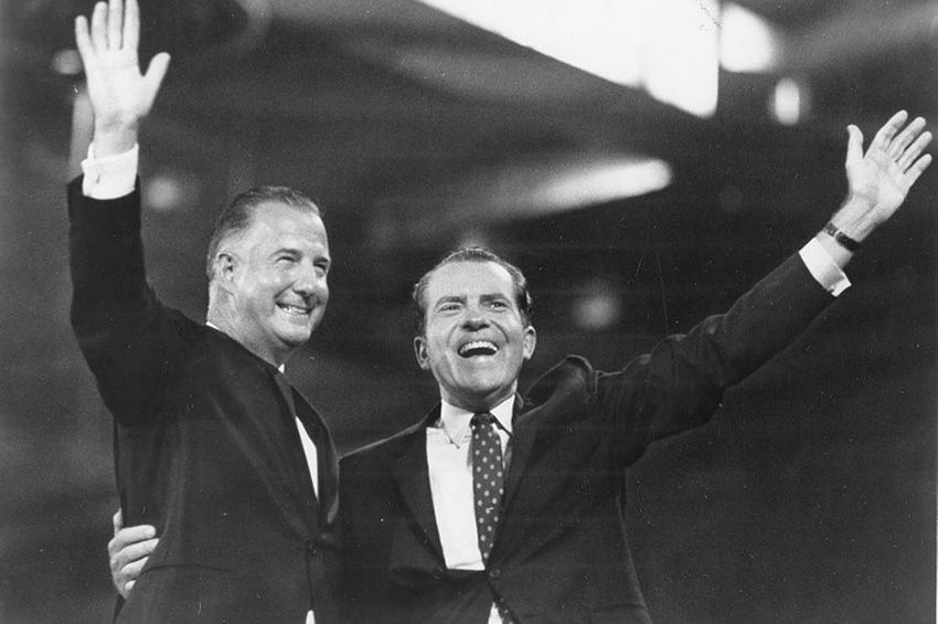 Spiro T. Agnew on left and Richard Nixon on right wave from the stage of the 1968 Republican National Convention