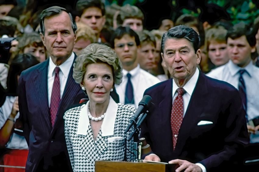 President Ronald Reagan, First Lady Nancy Reagan, and Vice President George H.W. Bush deliver remarks from the South Lawn of the White House