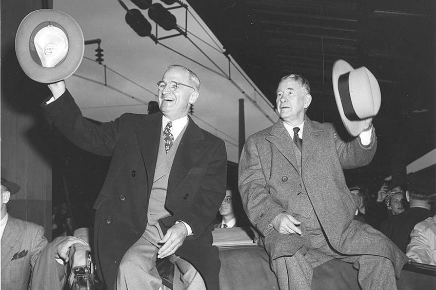 President Harry S. Truman and Vice President-elect Alben Barkley wave to a crowd in Washington DC after their election victory