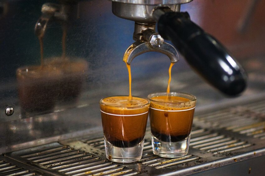 Two shots of espresso being made