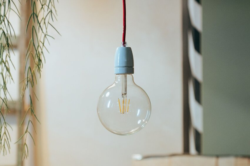 A lightbulb hanging in a room